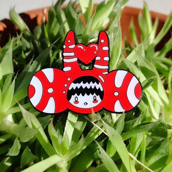 enamel lapel pin or badge with custom printed Joe Scribble graphic cartoon design